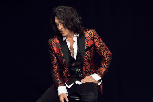 Paul Stanley sits in a flamboyant jacket to promote Soul Station