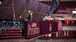 a crew member adjusts the lighting rig at the royal albert hall ahead of the launch of the bbc proms on friday c sim canetty clarke uai - Audio Media International